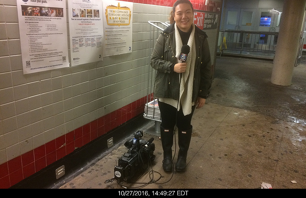 A Fox News producer at work in the subway corridor leading to the entrance of Hunter College