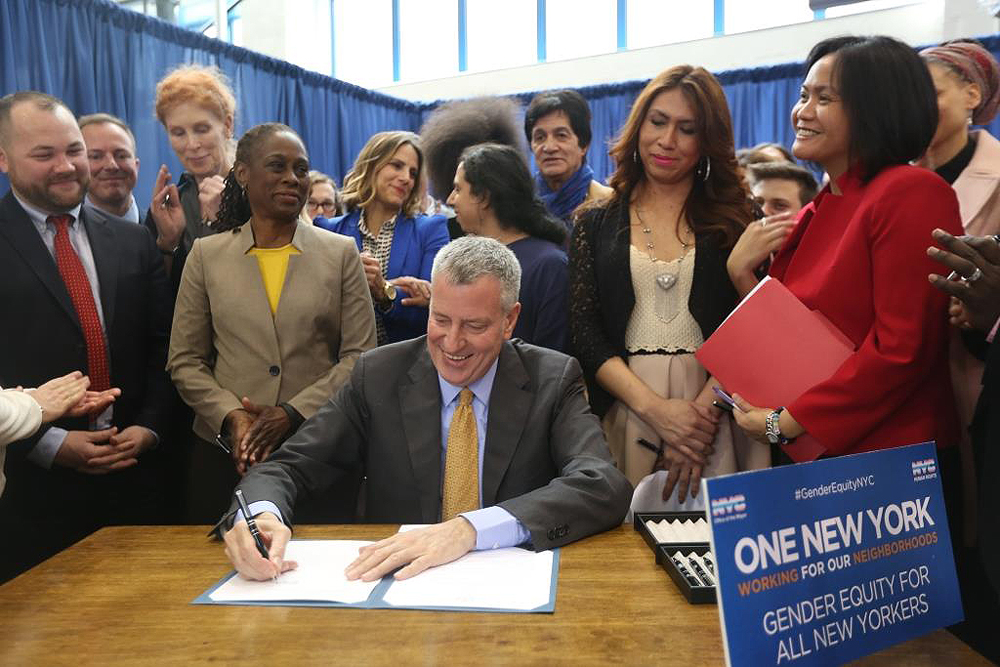 Human Rights Commissioner Carmelyn P. Malalis, right, joined Mayor Bill de Blasio during the Exeutivr Order #16 that will make NYC bathrooms safer for transgender people. Photo Credit: Mariela Lombard for NYC Commission of Human Rights.