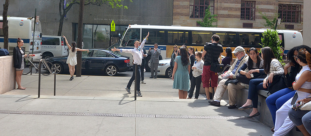 A spring time performance by students in front of the Hunter North Building.